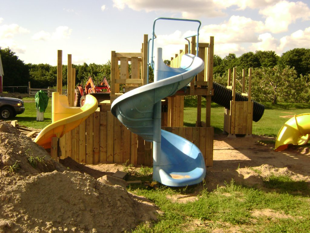 Slides attached to play set